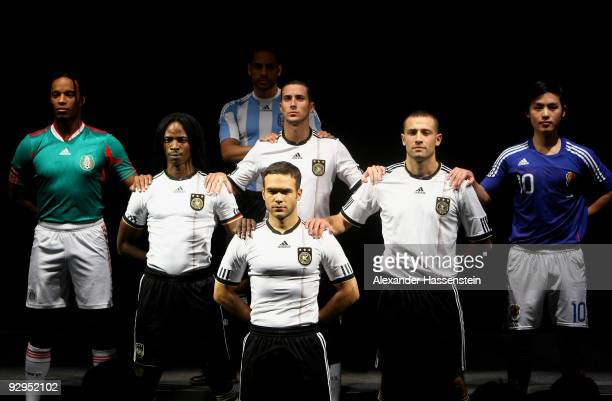 Models present the new German FIFA World Cup 2010 jersey 'Teamgeist' at the adidas Brand Center on November 10 2009 in Herzogenaurach Germany