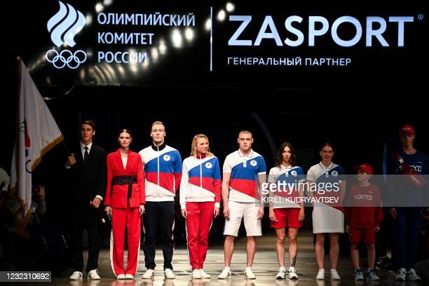 Models present the Russian Olympic Team uniform for the Tokyo 2020 Olympic Games, designed and manufactured by ZASPORT clothing company, in Moscow on...