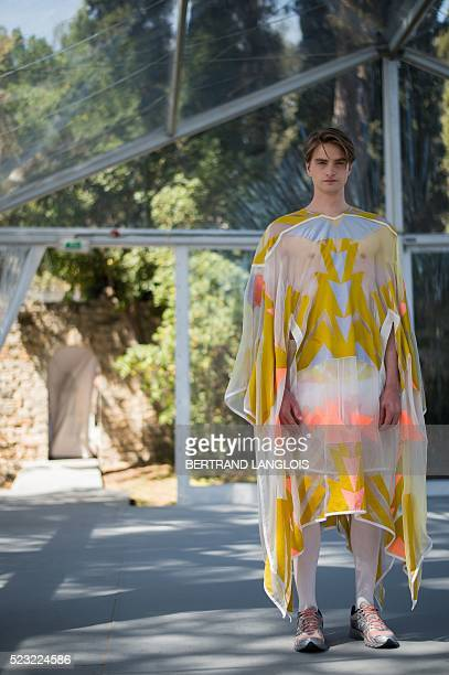 Models present to the jury creations of Finnish Rolf Ekroth during the 31st edition of the International Festival of Fashion and Photography at the...