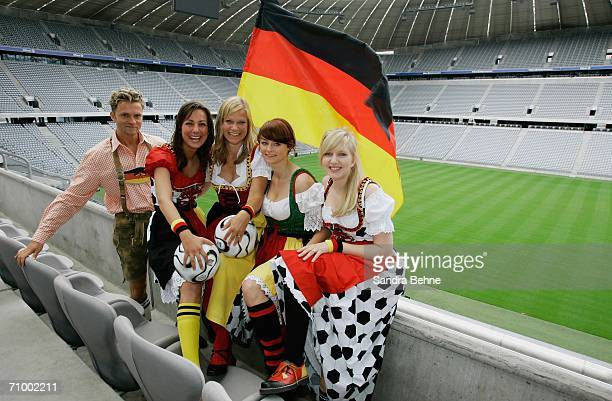 Models present traditional Bavarian clothes in a football style at the Allianz Arena on May 21, 2006 in Munich, Germany. The collection has been...
