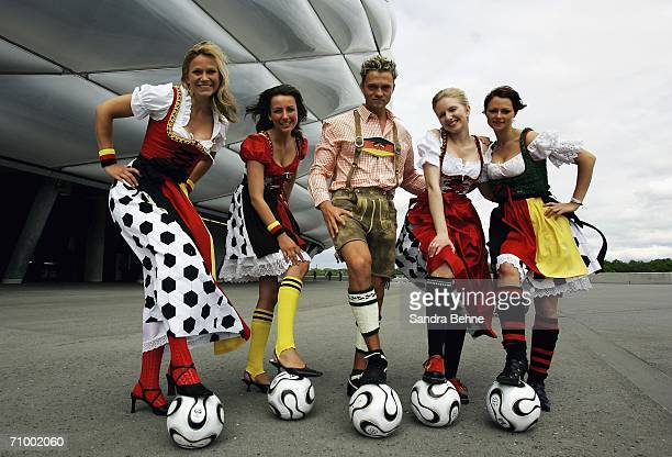 Models present traditional Bavarian clothes in a football theme at the Allianz Arena on May 21, 2006 in Munich, Germany. The collection has been...