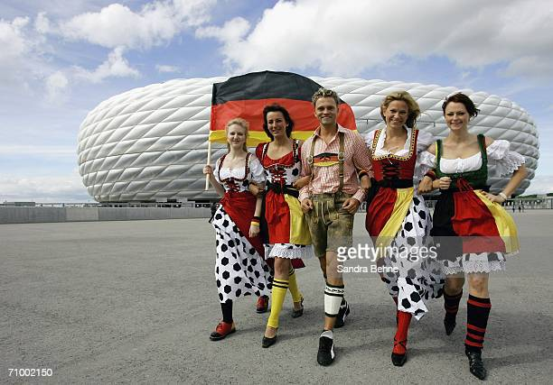 Models present traditional Bavarian clothes in football style at the Allianz Arena on May 21, 2006 in Munich, Germany. The collection has been...