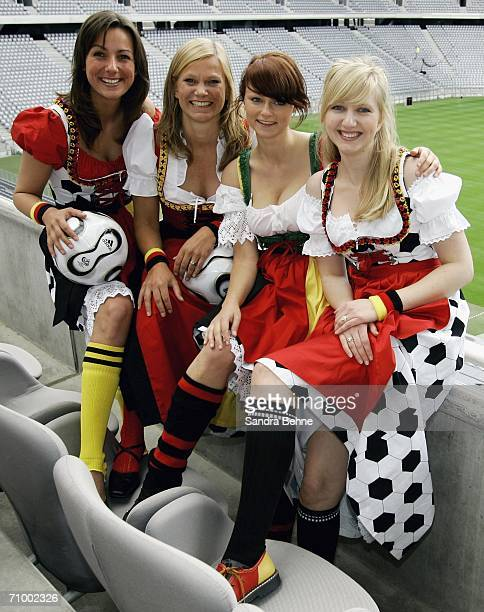 Models present traditional Bavarian clothes in football style at the Allianz Arena on May 21 2006 in Munich Germany The collection has been...