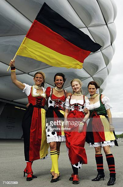 Models present traditional Bavarian clothes in football theme at the Allianz Arena on May 21, 2006 in Munich, Germany. The collection has been...