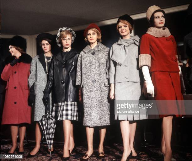 Models present women's fashion of the autumn and winter collection 1961.