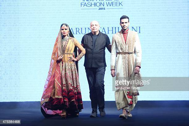 Models presenting the collection by designer Tarun Tahiliani during the launch of BMW India Bridal Fashion Week 2015 along with unveiling of the BMW...