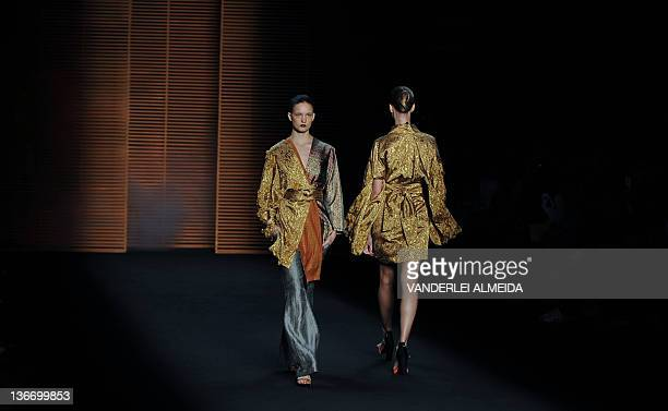 A models presents a creation by designer Patachou during first day of the Rio Fashion Week Winter 2012 collection at the Pier Maua in Rio de Janeiro...