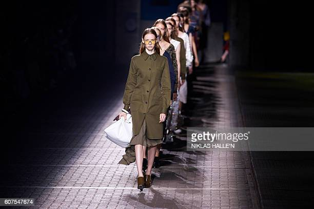 Models presents creations by Mulberry during their 2017 Spring / Summer catwalk show at London Fashion Week in London, England on September 18, 2016....
