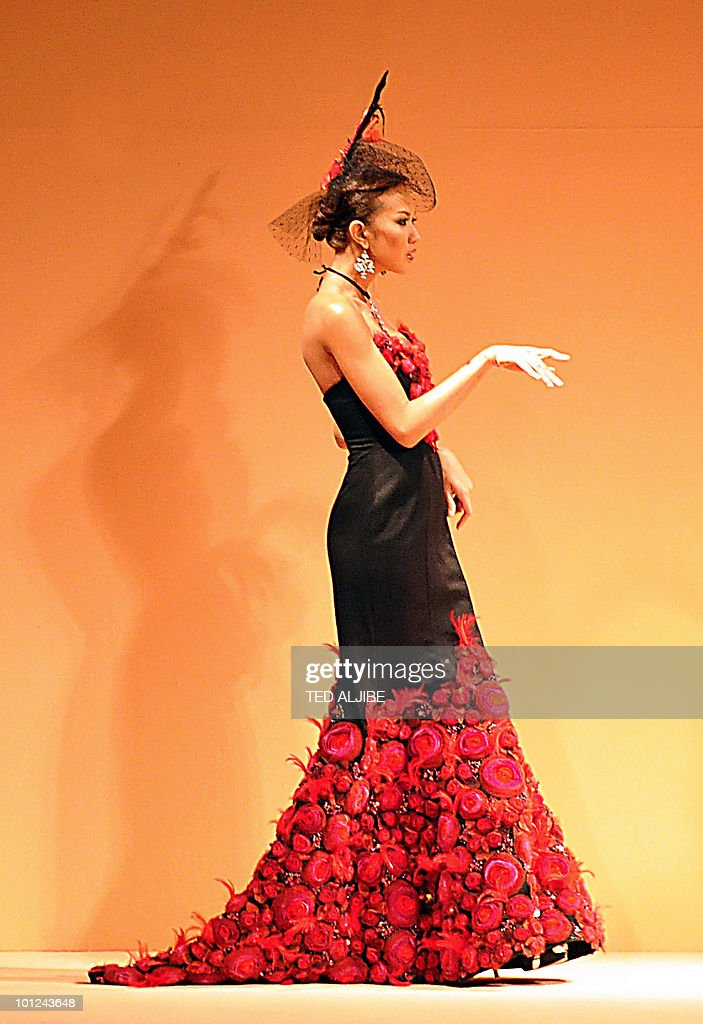 A models presents creations by Philippine designer Jontie Martinez during the Philippine Fashion week in Manila on May 28, 2010. The Philippines fashion show is being held from May 27 to June 1, 2010.