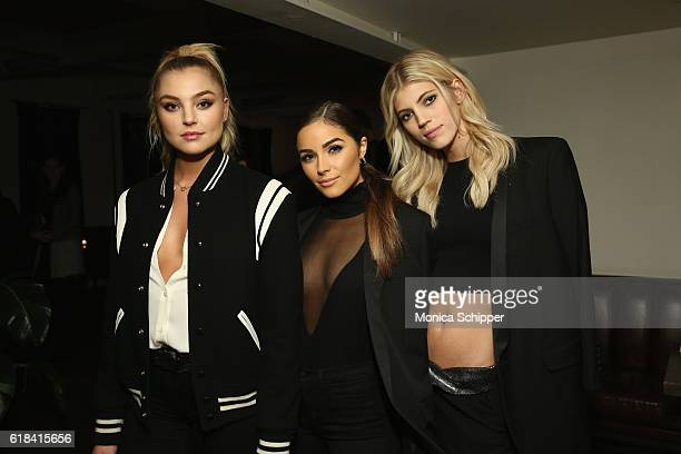Models Rachel Hilbert Olivia Culpo and Devon Windsor attend Stuart Weitzman's Launch Of The Gigi Boot on October 26 2016 in New York City