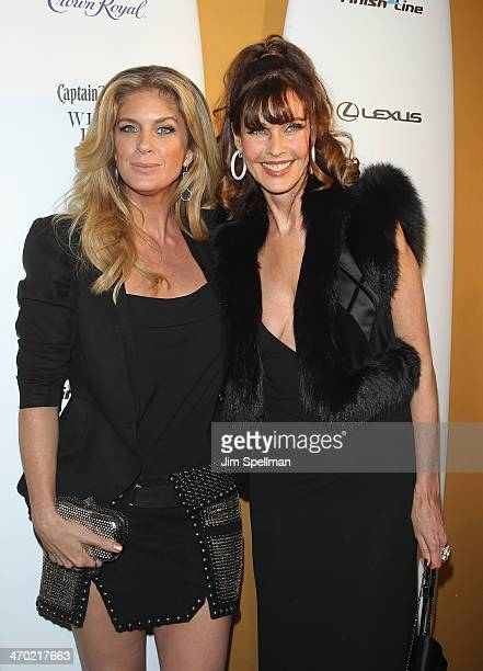 Models Rachel Hunter and Carol Alt attend the Sports Illustrated Swimsuit 50th Anniversary Party at Swimsuit Beach House on February 18 2014 in New...