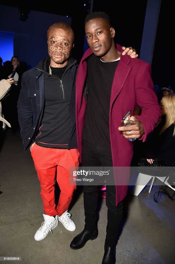Models Ralph Souffrant (L) and David Agbodji attend the Laquan Smith front row during New York Fashion Week: The Shows at Gallery I at Spring Studios on February 14, 2018 in New York City.