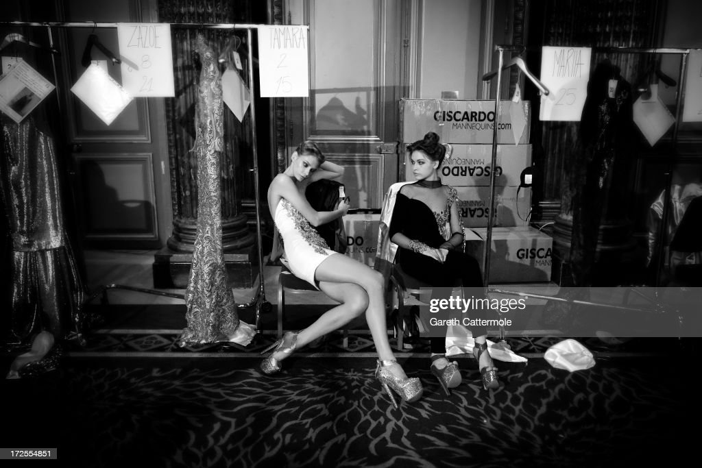Models relax backstage before the Tony Yaacoub show as part of Paris Fashion Week Haute-Couture Fall/Winter 2013-2014 at Hotel Westin on July 2, 2013 in Paris, France.