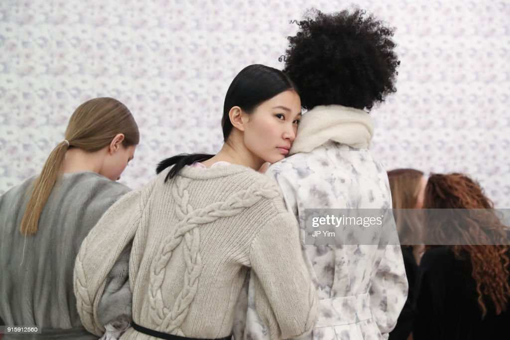 Models rest before the Alejandra Alonso Rojas FW18 Collection on February 8, 2018 in New York City.