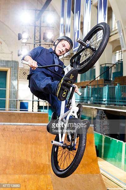 Models ride BMX's during the Jimmy Choo presentation during The London Collections Men SS16 at Seymor Leisure Centre on June 15 2015 in London England