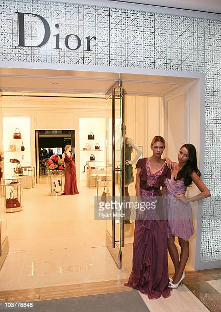Models Rina Roe and Colleen Hunter pose during the Christian Dior Store Opening at South Coast Plaza on September 1 2010 in Costa Mesa California