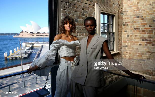 Models Roberta Pecoraro and Akima pose backstage during the Mercedes-Benz Presents Aje show at Mercedes-Benz Fashion Week Resort 20 Collections at...