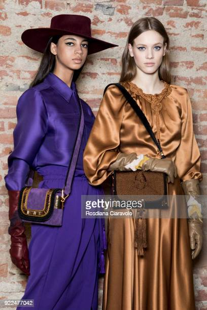 Models Rocio Marconi and Sarah Dahl are seen backstage ahead of the Alberta Ferretti show during Milan Fashion Week Fall/Winter 2018/19 on February...