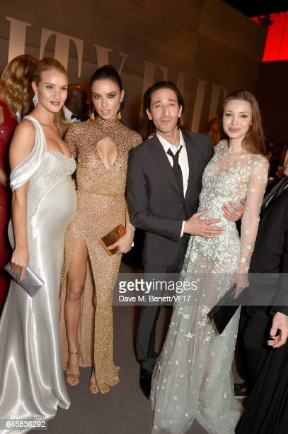 Models Rosie HuntingtonWhiteley Adriana Lima actor Adrien Brody and Lara Lieto attend the 2017 Vanity Fair Oscar Party hosted by Graydon Carter at...