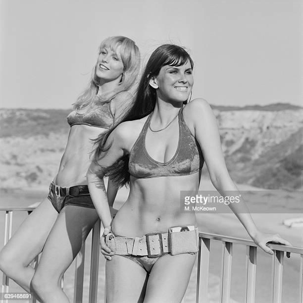 Models Sally Bodington and Caroline Munro wearing bikinis 19th May 1971