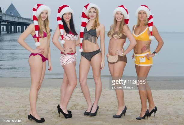 Models Sara, Alexandra, Julia, Sara, Jennifer and Karolina wearing bikini fashions from various decades on the beach at Heringsdorf on the island of...