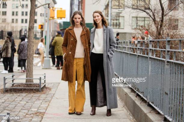 Models Sara Blomqvist Alana Zimmer after the Zimmermann show on February 12 2018 in New York City Sara wears a brown suede coat light pink tan...