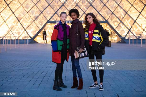 Models Sara Grace Wallerstedt, Blesnya Minher, and Danielle Lashley after the Louis Vuitton show at the Louvre Museum during Paris Fashion Week...