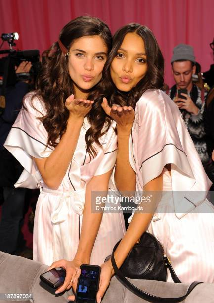Models Sara Sampaio and Lais Ribeiro prepare at the 2013 Victoria's Secret Fashion Show hair and makeup room at Lexington Avenue Armory on November...