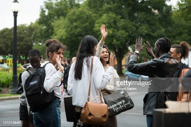 Models say goodbye outside the Royal Exhibition Building on March 13 2020 in Melbourne Australia Melbourne Fashion Festival organisers announced on...