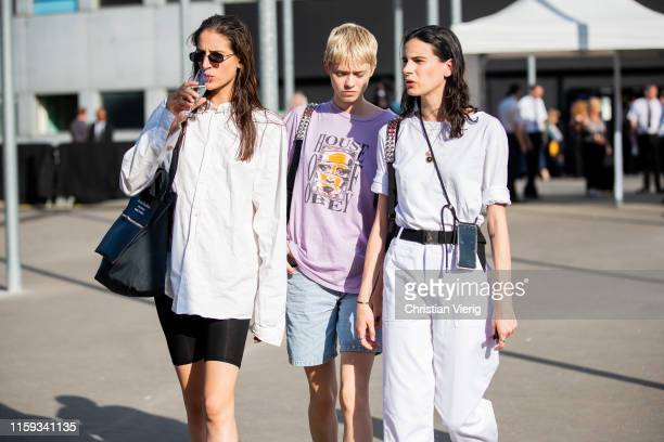 Models seen outside Acne during Paris Fashion Week Haute Couture Fall/Winter 2019/2020 on June 30 2019 in Paris France