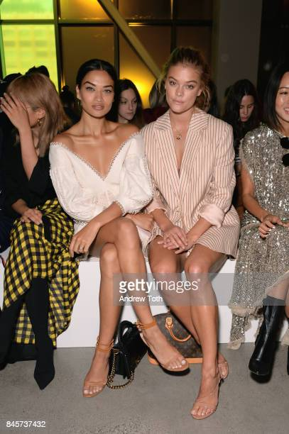 Model's Shanina Shaik Nina Agdal attend Zimmermann fashion show during New York Fashion Week The Shows at Spring Studios on September 11 2017 in New...
