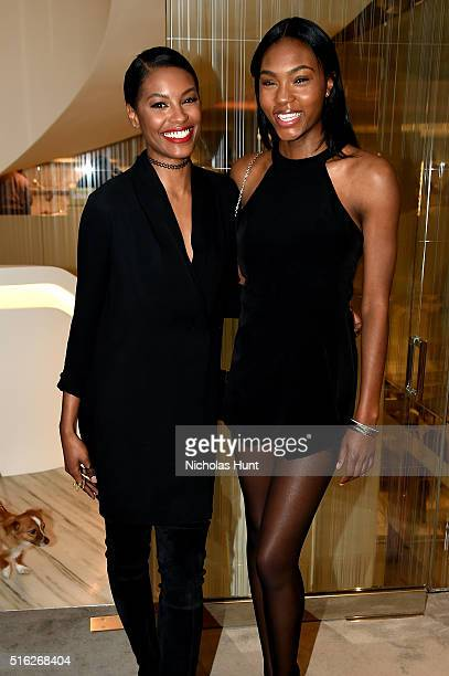 Models Sharam Diniz and Afiya Bennett attend as Barneys New York celebrates its new downtown flagship in New York City on March 17 2016 in New York...
