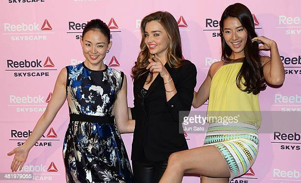 Models Shiho Miranda Kerr and Sumire attend the Reebok Skyscape party photocall on April 2 2014 in Tokyo Japan