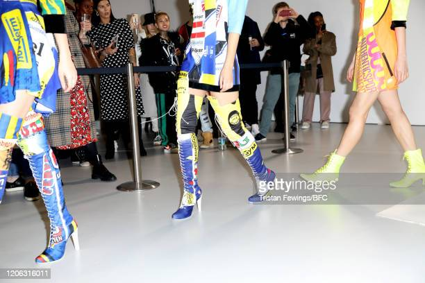 Models shoe detail pose at the Agne Kuzmickaite AW20 presentation during London Fashion Week February 2020 at Victoria House on February 14 2020 in...
