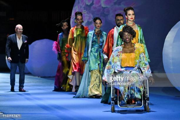 Models show a creation by Colombian designer Carlos Armando Buitrago during the Walkway Inclusion fashion show in Cali Colombia on May 16 2019 People...