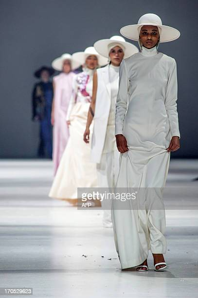 Models show creations on the catwalk on June 13, 2013 during the VIP night and premiere of the graduation fashion show, showcasing the creations of...