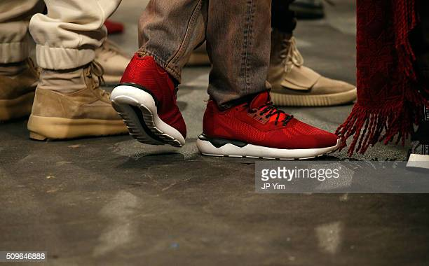 Models show detail pose wearing Addidas Yeezy Boost shoes during Kanye West Yeezy Season 3 on February 11 2016 in New York City