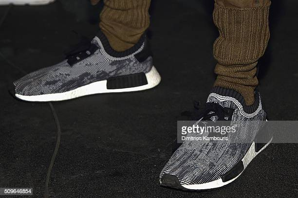 Models show detail pose wearing Addidas Yeezy Boost sneakers during Kanye West Yeezy Season 3 on February 11 2016 in New York City