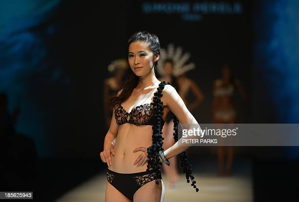 Models show off creations by Simone Perele during the Shanghai Mode Lingerie Fashion show in Shanghai on October 23 2013 The show is a part of...