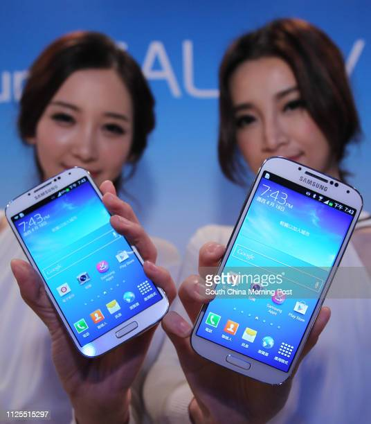 Models show the Samsung GALAXY S4, which will go on sale starting on April 27th in Hong Kong. The suggested retail price is HK$5,898. Pictured during...