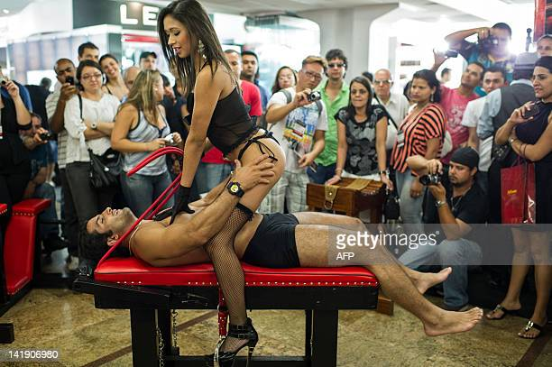 Models show the use of the special furniture for sex at Erotika Fair in Sao Paulo Brazil on March 25 2012 The annual fair of products and services...
