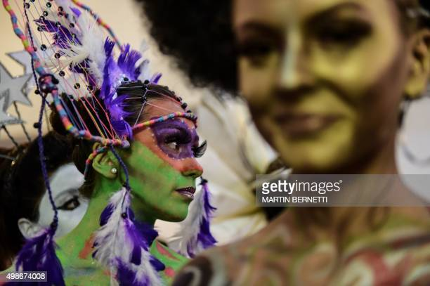 Models show their bodies painted by art students of the Chilean institute AIEP during an exhibition of body painting during which they displayed more...