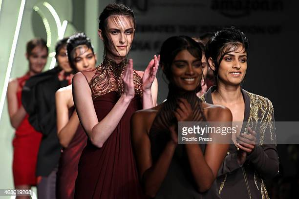 Models showcase a creation By Indian Designer Gaurav Gupta during the Fourth Day of Amazon India Fashion Week AutumnWinter 2015