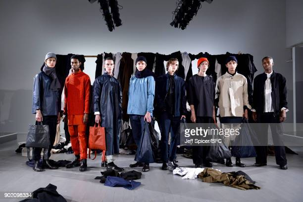 Models showcase a design at the Phoebe English MAN presentation during London Fashion Week Men's January 2018 at BFC Show Space on January 7, 2018 in...