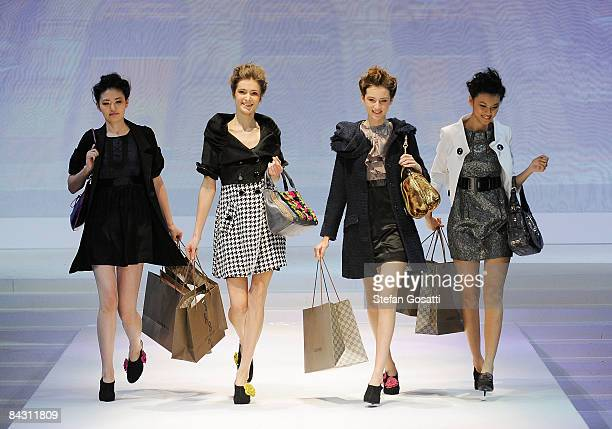 Models showcase bags by Cocomojo as part of the Brand Collections Show 2 on the catwalk as part of Hong Kong Fashion Week Fall/Winter 2009 at the...
