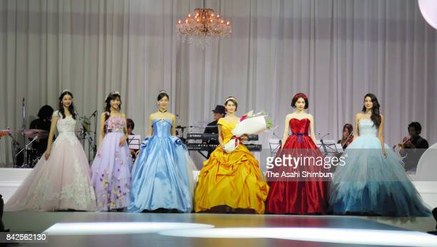models showcase colorful wedding dresses representing six popular Disney princesses on August 30 2017 in Tokyo Japan Fourteen designs featuring six...