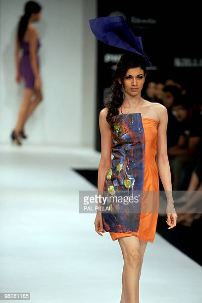 Models showcase creations by Indian designer Nidhi and Divya Gambhir on the fifth and final day of Lakme Fashion Week Summer/Resort 2010 in Mumbai on...