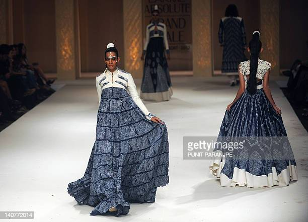 Models showcase creations by Indian designer Rohit Bal during the grand finale of the Lakme Fashion Week summer resort 2012 in Mumbai on March 6 2012...