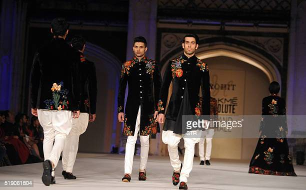 Models showcase creations by Indian designer Rohit Bal during the final show at Lakme Fashion Week summer/resort 2016 in Mumbai on late April 3 2016...