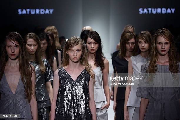 Models showcase design by Saturday during the Audi Fashion Festival on day two at Tent at Orchard on May 15 2014 in Singapore